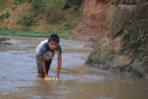 Boy Collecting Dirty Water