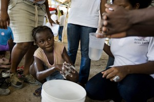 A child washes her hands during educational activities held for the Global Handwashing day at a refugee camp in Port au Prince. Millions of children around the world are getting ready for the third annual Global Handwashing day, to be held globally on October 15 2010.