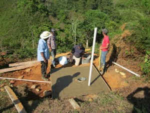 Latrine building with comm members